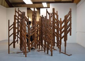 Sky the Color of Cement, 2014, oxidized wood, oxidized steel and hardware, 10' x 9' x 10.5'