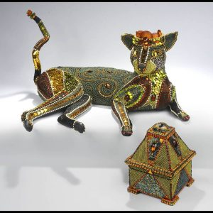 Bobcat with beaded mp3 and box, mixed media including beads, taxidermy form, etc., 2012