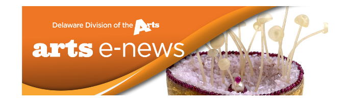 Delaware Division of the Arts e-news logo on orange background in upper left corner slightly covering a yellow and purple sculpture with off white tendrils coming out its top that is on the right side of the banner