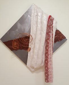 artwork with metal, fabric and paint