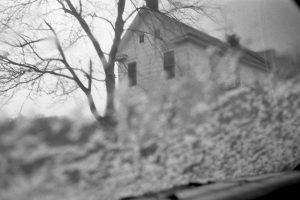 photograph of an old house in background