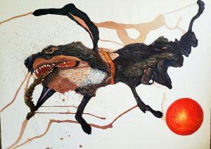 black dog with orange ball