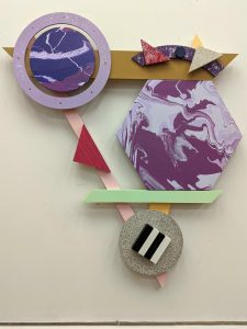 three dimensional wall hanging of geometric shapes