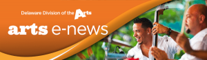 Arts E News banner with the logo and division logo on an orange graphic in the upper left corner and an image of two men playing instruments on a stage outside on the right side